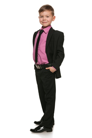 A portrait of a handsome young boy in black suit on the white background Stock Photo - 18815925