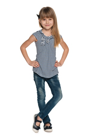 portrait young girl studio: A portrait of a pretty young girl in striped blouse and jeans on the white background Stock Photo