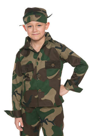 A portrait of a boy dressed in camouflage; on the white background photo