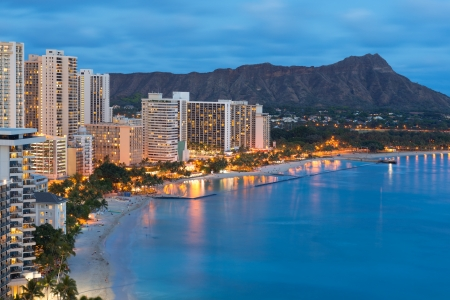 tourist resort: Scenic view of Honolulu city, Diamond Head and Waikiki Beach at night; Hawaii, USA
