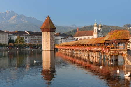 Chapel Bridge and Water Tower in Luzern in the morning photo