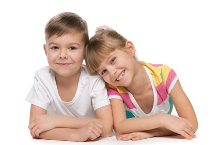 brothers and sisters: Happy kids are lying together on the floor