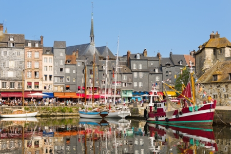 Yachts in the Honfleur harbour in a summer day