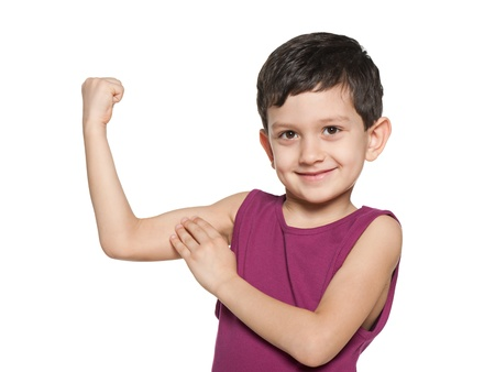 kids exercise: A smiling boy is showing the results of morning exercises Stock Photo