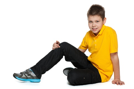 yellow shirt: A smiling boy in yellow shirt on the white background