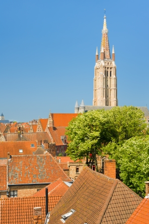 The Our Lady Church in Bruges in a sunny summer day photo