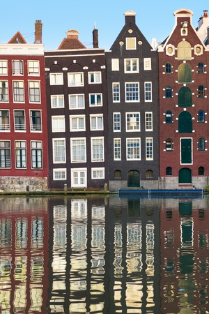 Wonderful view on old houses of Amsterdam in the evening photo