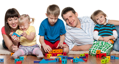 Mother, father, two sons and a daughter are playing on the floor photo