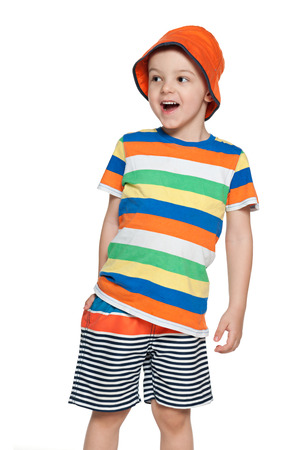 A little boy looks away with delight Stock Photo