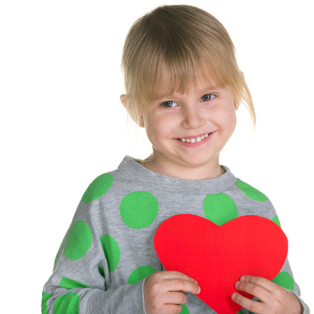 A little girl is holding a red heart on the white background photo
