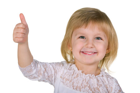 A portrait of a cheerful little girl  with her thumb up on the white background photo