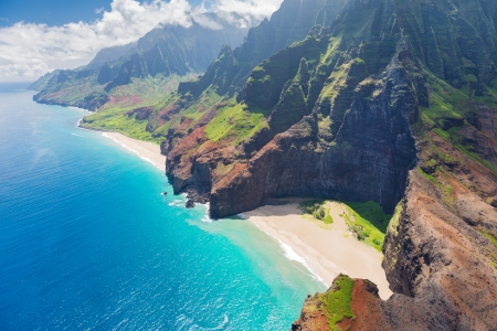 View on Na Pali Cost on Kauai island on Hawaii in a cloudy day photo