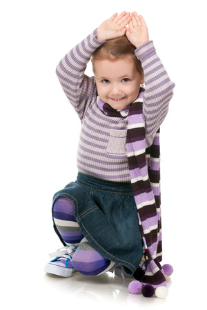 A portrait of a fashion little girl in striped sweater on the white background photo