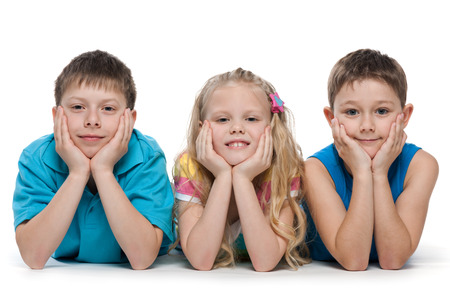 A portrait of a group of three children on the white background photo