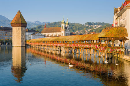 Chapel Bridge and Water Tower in Luzern in the early morning photo
