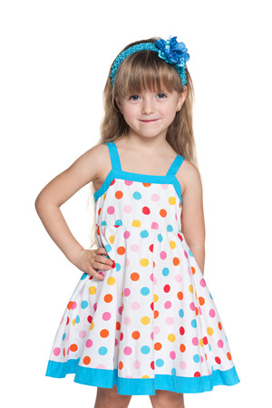 Portrait of a small girl in polka dot dress on the white