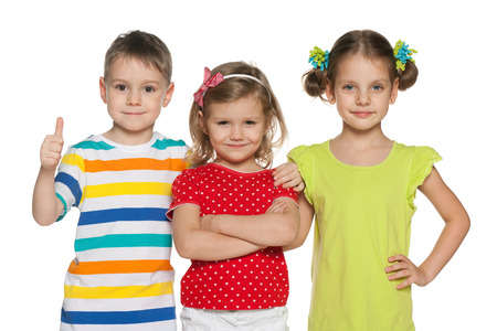 brother and sister: Portrait of three cheerful preschoolers on the white background