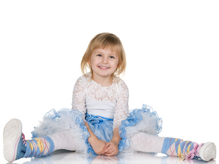 A portrait of a cheerful little girl on the white background photo