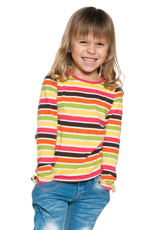 A portrait of a laughing  little girl in striped shirt on the white background photo