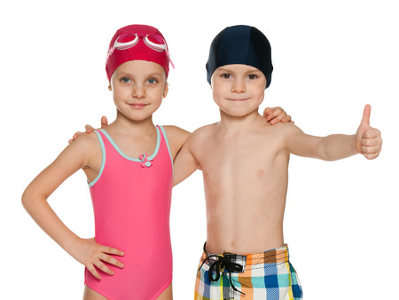 Portrait of two children in swimsuits on the white background