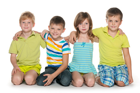A portrait of four smiling children on the white background photo