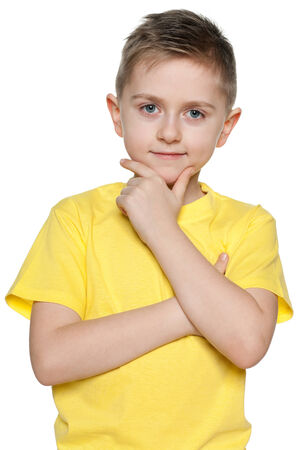 yellow shirt: A portrait of a cute young boy in yellow shirt on the white background