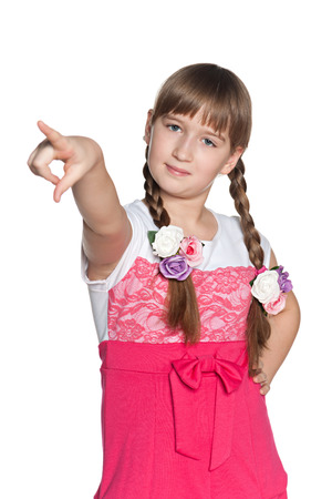 hand gestures: A portrait of a confident young girl pointing forward