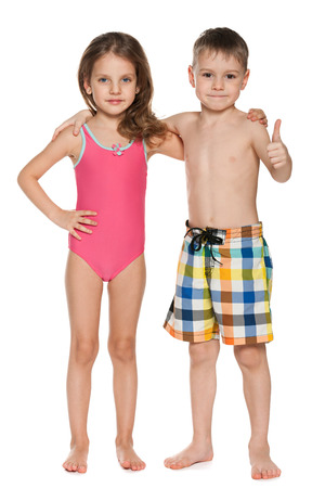 preschooler: A portrait of two children in swimsuits on the white background Stock Photo