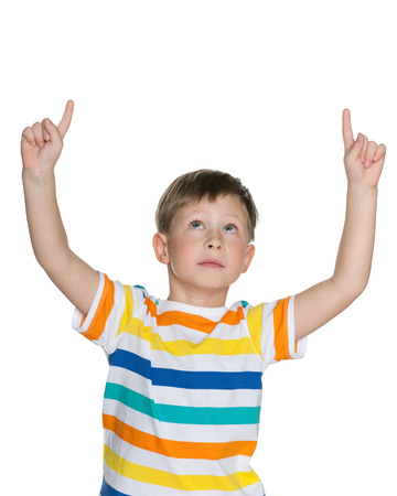 hands out: Portrait of a pensive boy showing his fingers up on the white background
