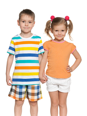 brothers and sisters: Portrait of two happy children which standing together on the white background