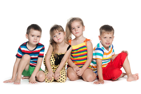 four friends: Four preschool children are sitting on the floor Stock Photo