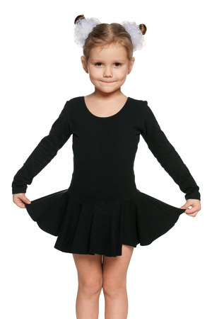A portrait of a pretty little girl dancing  photo