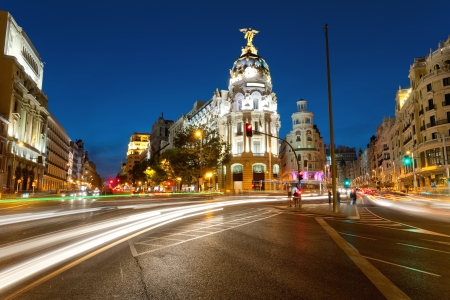 Crossing Alcala and Gran Via street in Madrid by night photo
