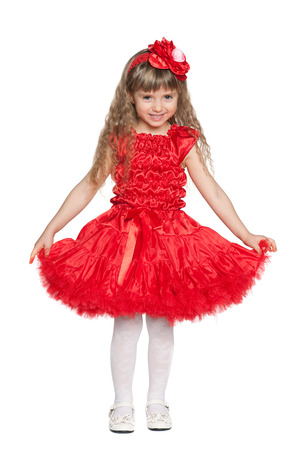 girl in red dress: Portrait of a little girl in a red dress on the white background