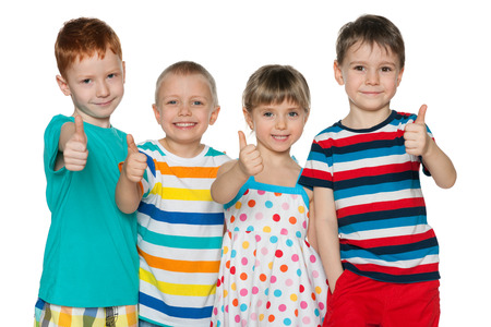 thumbs up group: Portrait of a group of four cheerful children hold his thumbs up on the white background Stock Photo