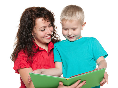 A smiling mother and her son are reading a book photo