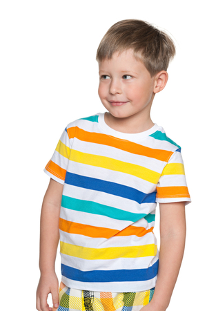 aside: A portrait of a smiling young boy in striped shirt looking aside Stock Photo