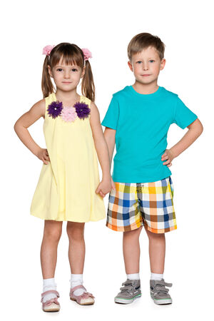 Portrait of two fashion children on the white background photo