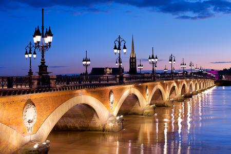 Night view on The Pont de pierre in Bordeaux