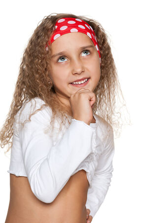 imagines: A little girl imagines on the white background Stock Photo