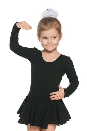A closeup portrait of a dancing little girl on the white background photo