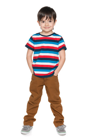 alone boy: A portrait of a young smiling boy in striped shirt on the white background
