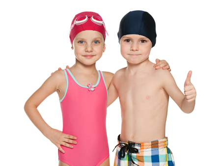 child swimsuit: Portrait of two smiling children in swimsuits on the white