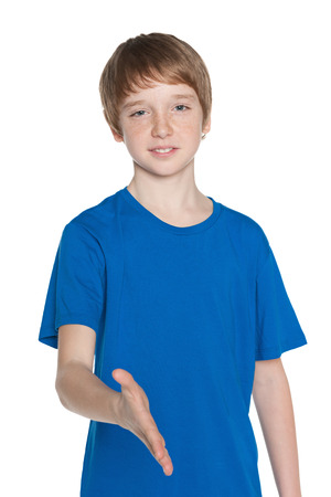 preteen boy: Preteen boy is going to shake a hand