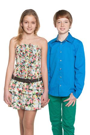 Portrait of two walking fashion preteen children on the white background photo