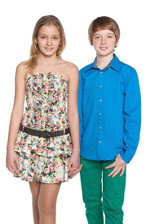 Portrait of two walking fashion preteen children on the white background photo