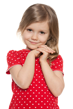 cute little girl smiling: Cute preschool girl on the white background Stock Photo