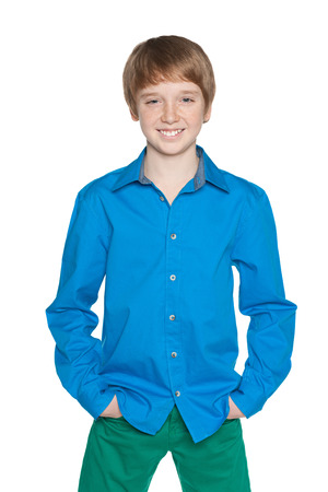 A portrait of a fashion preteen boy on the white background Stock Photo