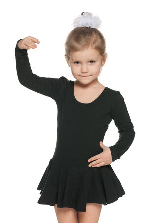 Portrait of a dancing little girl against the white background photo