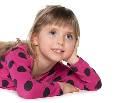 imagines: A thoughtful little girl imagines on the white background
